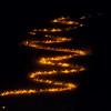 Fiaccolata di Capodanno dal Monte Lussari - Alpi Giulie <br /> Discesa dalla pista da sci 'Di Prampero', qui nella rampa finale, accanto alla stazione della funivia Promotur a Camporosso-Tarvisio, in fondo valle.<br /> <br /> Foto n° 010114-8125