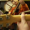 Record-Eagle/Garret Leiva<br /> Viaggio Chavez, 7, of Traverse City, plays along on his guitar during the fiddle jamboree Saturday evening in the kitchen at Gilbert Lodge at Twin Lakes Camp.