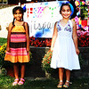 Debbie Blank | The Herald-Tribune<br /> Fiesta Hispana was a colorful scene with decorations made by Spanish students, flowers, balloons and pretty dresses worn by two 5-year-olds, Mia Camarena, Batesville, and Ariana Cisneros, Sunman.