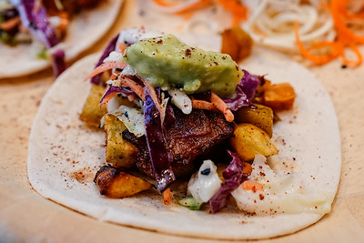 Ancho sweet potato bacon tacos with a cherry sesame slaw topped off with a citrus avocado puree