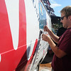 "Matt Gagnon pours beer from the Left Hand beer keg truck at the festival.<br /> Colorado firefighters were celebrated with the first annual Fight Fire with Beer Festival on the 29th Street Mall plaza on Saturday.<br /> For more photos and a video of the festival, go to  <a href=""http://www.dailycamera.com"">http://www.dailycamera.com</a>.<br /> Cliff Grassmick  / September 15, 2012"