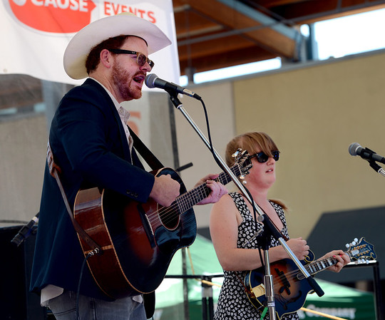 "Taylor Sims and his wife Bonnie, play at the Beer festival. Both are part of the group, ""Bonnie and the Clydes.""<br /> Colorado firefighters were celebrated with the first annual Fight Fire with Beer Festival on the 29th Street Mall plaza on Saturday.<br /> For more photos and a video of the festival, go to  <a href=""http://www.dailycamera.com"">http://www.dailycamera.com</a>.<br /> Cliff Grassmick  / September 15, 2012"