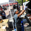 "Ruben Garcia, of Outlawz BBQ, checks the meat during the festival.<br /> Colorado firefighters were celebrated with the first annual Fight Fire with Beer Festival on the 29th Street Mall plaza on Saturday.<br /> For more photos and a video of the festival, go to  <a href=""http://www.dailycamera.com"">http://www.dailycamera.com</a>.<br /> Cliff Grassmick  / September 15, 2012"