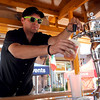 "Lucas Allen of Oskar Blues Brewery, pours a glass of beer during the festival.<br /> Colorado firefighters were celebrated with the first annual Fight Fire with Beer Festival on the 29th Street Mall plaza on Saturday.<br /> For more photos and a video of the festival, go to  <a href=""http://www.dailycamera.com"">http://www.dailycamera.com</a>.<br /> Cliff Grassmick  / September 15, 2012"