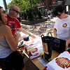"""Laura Bowles and Rob Reilly, buy beer mugs from Beth Merfish during the festival.<br /> Colorado firefighters were celebrated with the first annual Fight Fire with Beer Festival on the 29th Street Mall plaza on Saturday.<br /> For more photos and a video of the festival, go to  <a href=""""http://www.dailycamera.com"""">http://www.dailycamera.com</a>.<br /> Cliff Grassmick  / September 15, 2012"""