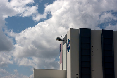 Helo flying cover as the astronauts head to the launch pad. T-4 hours.