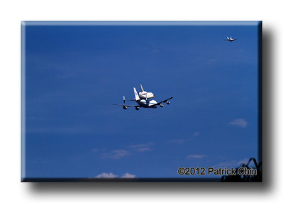 There were two fighter planes escorting Endeavour's final journey, and one of them can be seen in this photo.