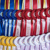 Record-Eagle/Douglas Tesner<br /> Ribbons hang from a wall waiting to by won by riders and horses in the 2008 Horse Show by the Bay.