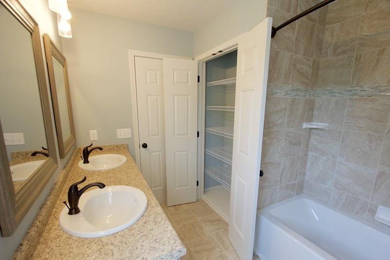 Master bathroom and linen closet