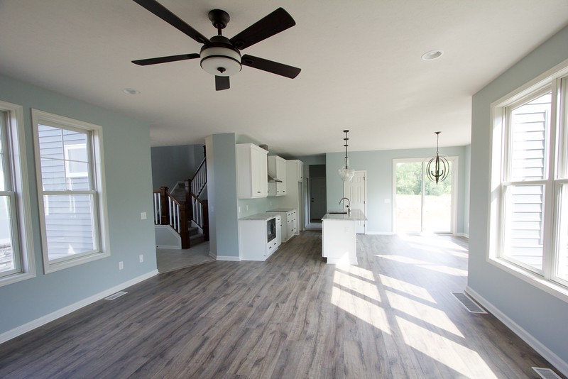 Standing in great room looking into foyer/ kitchen/ dining