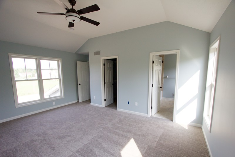 Master bedroom looking into bathroom and walk in closet