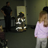 2/17/2010 - showing the kids all the fire fighting gear they have to wear...