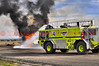 Loveland FD-Crash Truck 4, working to put out a simulated aircraft fire at Fort Collins-Loveland Municipal Airport (FNL) in east Loveland, Colorado, USA. October 17, 2013