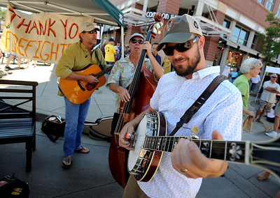 Robby Loeb, right, John Whiteman, left, and Steve Berry, all of Buffalo 5 Piece, play to thank the firefighters before the parade. A special parade  for the Fourmile firefighters was held during the Boulder Green Streets celebration. For a video of the parade, go to www.dailycamera.com. Cliff Grassmick / September 19, 2010