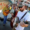 "Robby Loeb, right, John Whiteman, left, and Steve Berry, all of Buffalo 5 Piece, play to thank the firefighters before the parade.<br /> A special parade  for the Fourmile firefighters was held during the Boulder Green Streets celebration.<br /> For a video of the parade, go to  <a href=""http://www.dailycamera.com"">http://www.dailycamera.com</a>.<br /> Cliff Grassmick / September 19, 2010"