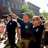 "Bob Oliver, left, and Melody Pray, both of Boulder Mountain Fire District, walk in the parade down Pearl Street on Sunday.<br /> A special parade  for the Fourmile firefighters was held during the Boulder Green Streets celebration.<br /> For a video of the parade, go to  <a href=""http://www.dailycamera.com"">http://www.dailycamera.com</a>.<br /> Cliff Grassmick / September 19, 2010"
