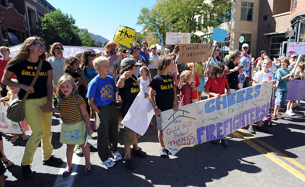 "Gold Hill Elementary showed up in force to thank firefighters.<br /> A special parade  for the Fourmile firefighters was held during the Boulder Green Streets celebration.<br /> For a video of the parade, go to  <a href=""http://www.dailycamera.com"">http://www.dailycamera.com</a>.<br /> Cliff Grassmick / September 19, 2010"