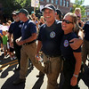 "Bob Oliver, left, hugs Melody Pray, both of Boulder Mountain Fire District, while they walk in the parade down Pearl Street on Sunday.<br /> A special parade  for the Fourmile firefighters was held during the Boulder Green Streets celebration.<br /> For a video of the parade, go to  <a href=""http://www.dailycamera.com"">http://www.dailycamera.com</a>.<br /> Cliff Grassmick / September 19, 2010"