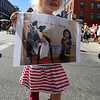 "Maisie Creamer, 3, walks in the parade with a picture she brought to honor the firefighters.<br /> A special parade  for the Fourmile firefighters was held during the Boulder Green Streets celebration.<br /> For a video of the parade, go to  <a href=""http://www.dailycamera.com"">http://www.dailycamera.com</a>.<br /> Cliff Grassmick / September 19, 2010"