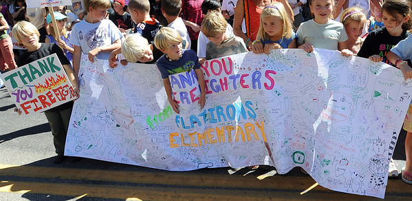 Flatirons Elementary students hold a special sign they made for the firefighters. A special parade  for the Fourmile firefighters was held during the Boulder Green Streets celebration. For a video of the parade, go to www.dailycamera.com. Cliff Grassmick / September 19, 2010