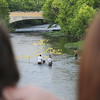 A crowd on the Mill Street bridge watches the Ducky Derby. — Tiffany Wolfe