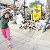Tiffany Wolfe/NEWS<br /> Shari Mastalski of Butler, an interpretive dance teacher and teaching artist with the Hoyt Center for the Arts Feed the Read program, does a street dance whil  James Knezetic of Salem, Ohio, accompanies her on the according. Watching the performance are, from left, 14-year-olds Anthony Houston, Joey Cugini, Marc Cimini and Jaycob Heasley. All four are from New Castle.