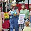Peggy Hanna of Slippery Rock Township, office manager with the New Castle Playhouse, advertises for the upcoming production of State Fair along with Paul Angelucci of Shenango Township, who is an actor in the show. The two were strolling East Washington Street on Saturday, during Day 2 of the Fireworks Festival featuring Arts on the Riverwalk. — Tiffany Wolfe