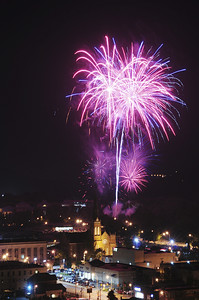As seen from atop the Scottish Rite Cathedral, fireworks explode over downtown New Castle. — Tiffany Wolfe