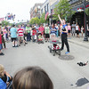 A crowd gathers on East Washington Street to watch juggler Geoff Bach of Erie.  — Tiffany Wolfe
