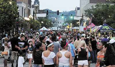 Tiffany Wolfe/NEWS East Washington Street is packed from sidewalk to sidewalk for Saturday's Fireworks Festival.