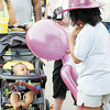 Tiffany Wolfe/NEWS<br /> Ten-month-old Niko Brown enjoys the compaby of Aubrey Phipps, 7, as their parents talks at Saturday's Fireworks Festival. Both families are from New Castle.