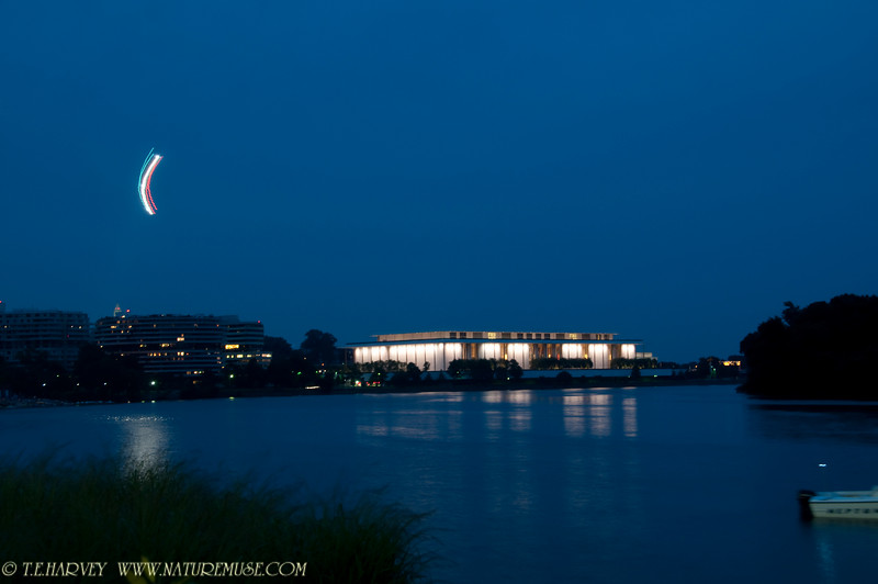 Cresent in sky is Park Police helicopter flying past Kennedy Center, Washington, D.C. prior to fireworks.