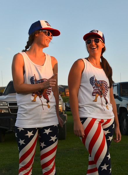 Justin Sheely | The Sheridan Press<br /> Erin Laarman, left, and Sarah Allen visit during the annual Independence Day celebration at the Big Horn Equestrian Center Wednesday, July 4, 2018.