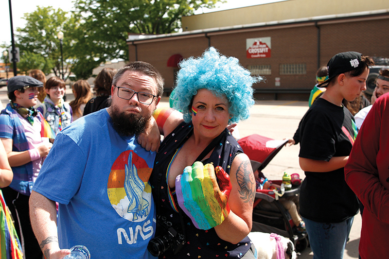 Matthew Gaston | The Sheridan Press<br>Jon Cates and Jenea Neeson show their support for Sheridan's LGBTQIA community during the Sheridan WYO Pride March Saturday, June 22, 2019.