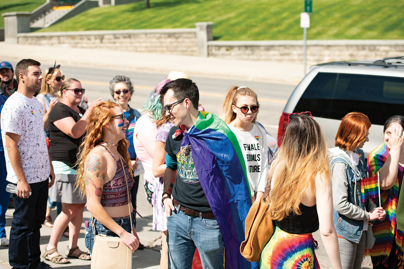 Matthew Gaston | The Sheridan Press<br>Parade participants line the sidewalk in front of the Sheridan County Courthouse patiently waiting to cross Coffeen Avenue before continuing down Main Street during the Sheridan WYO Pride March Saturday, June 22, 2019.