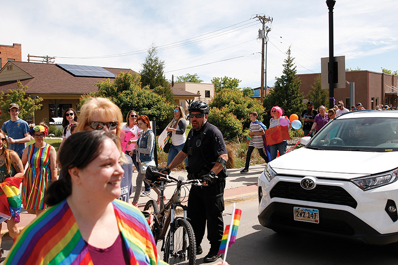 Matthew Gaston | The Sheridan Press<br>Sheridan Police officer Howie Fitzpatrick looks out for parade goers safety during the first Sheridan WYO Pride March Saturday, June 22, 2019.