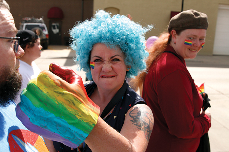 "Matthew Gaston | The Sheridan Press<br>Jenae Neeson flaunts her ""Pride Power"" during the first Sheridan WYO Pride March Saturday, June 22, 2019."