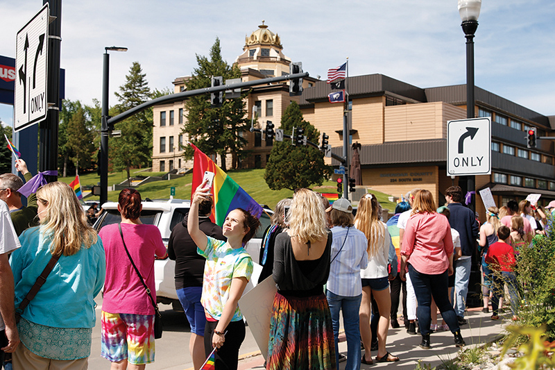 Matthew Gaston | The Sheridan Press<br>A young lady takes a selfie during the first Sheridan WYO Pride March Saturday, June 22, 2019.