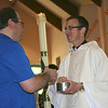 Br. Duane Lemke, one of Fr. Greg's formation directors, receives the Eucharist