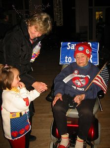 """This woman """"danced"""" to the music in her motorized chair, with """"Say NO to War"""" sign."""