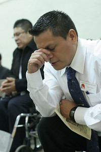 Mario Torres prays after receiving holy Communion.