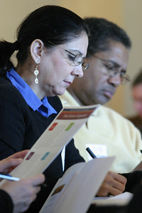 Maria Sierra of St. Theresa Church, Douglasville, foreground, and Leonard Chambliss of St. Philip Benizi Church, Jonesboro, look over materials and take notes during the Feb. 10 Best Practices In Stewardship workshop at Our Lady of the Assumption Church, Atlanta.
