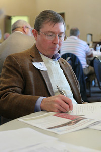 Carter Stout of Sacred Heart Church, Atlanta, takes notes during the Feb. 10 Stewardship Workshop at Our Lady of the Assumption Church, Atlanta.