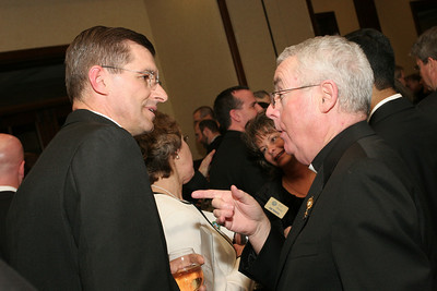 Father David Kluk, LC, left, and Father John Fallon converse during Shepherd's Night.