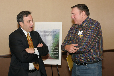 Over a break Joel Gray, right, director of stewardship at St. Brigid Church, Johns Creek, talks with Best Practices In Stewardship workshop speaker, Thomas Sonni of Greater Mission Development Services, Columbia, Md. Sonni was a morning speaker at the Feb. 10 workshop.