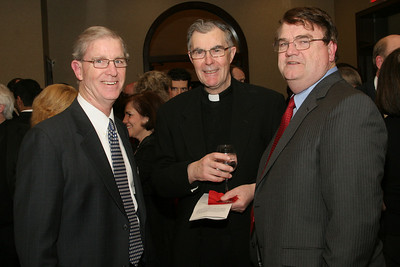 (L-r) MIchael Walsh of Holy Spirit Church, Father Paul Fogarty, pastor of St. Thomas More Church, Decatur, and Dennis MacKin of All Saints Church, attend Shepherd's Night at Holy Spirit Church, Atlanta.