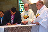 Juancho signs his vows documents — at Sacred Heart School of Theology.