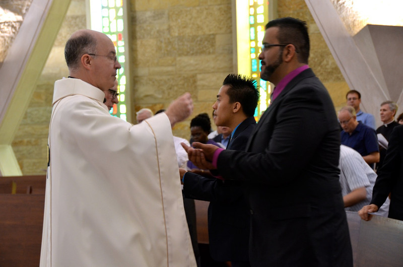 Fr. Steve shares the host with Juancho