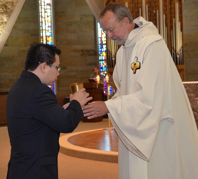 Fr. Byron Haaland shares the cup