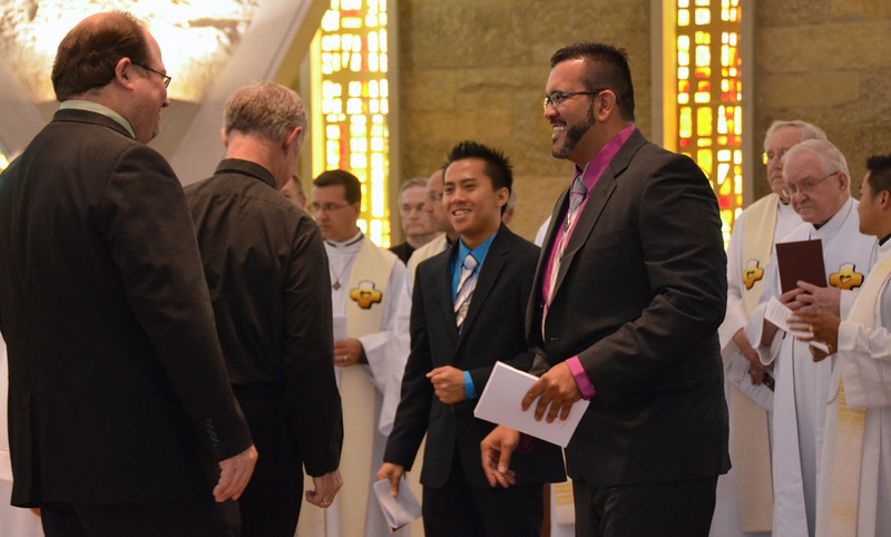 James and Juancho receive congratulations from Br. Duane Lemke and Fr. Tim Gray of the formation team — at Sacred Heart School of Theology.